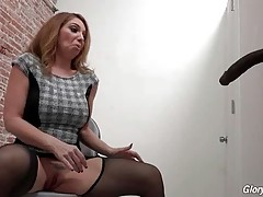 Blond milf is very glad to find large black dick in glory hole.