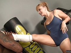 This blonde babe is working out in her sexy blue outfit. Her ebony man then comes in to help her finish up as things get hot. She gets down and starts to blow his massive cock getting him wet and ready for her pussy. He starts out by ramming her pussy dog