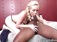 Miley May skillfully works her mouth at black dude`s boner.