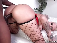 Nasty tattooed blonde tastes her anal juices from lover`s brown cock.